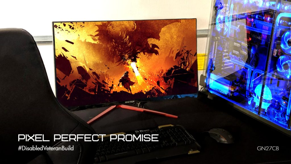 Photo of the GN27CB monitor on a desk next to a custom-built PC tower.
